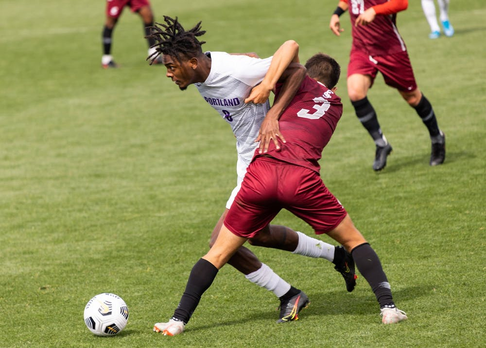 Midfielder Miles Robinson fights for the ball.
