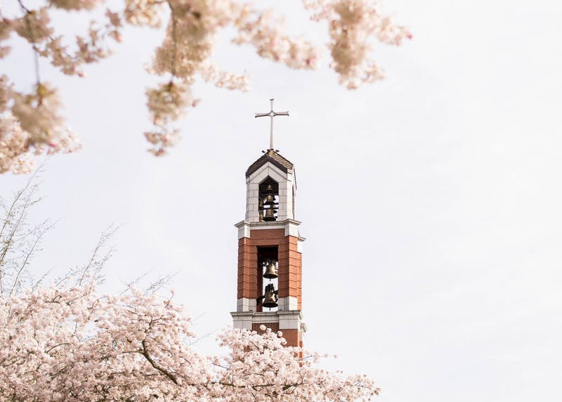 The bell tower sits among the cherry blossoms, signifying that Easter is around the corner.