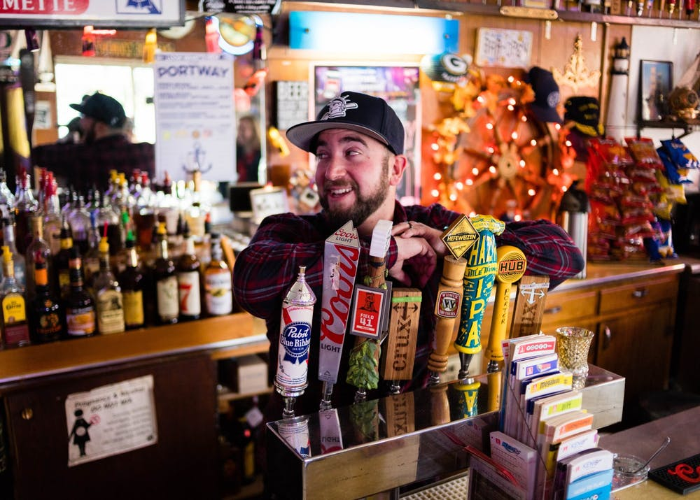 Tim Ward serves UP students over the age of 21 as their favorite neighborhood bartender and confidante at Portway Tavern.