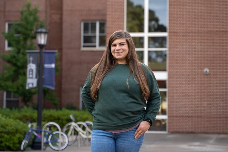 Fields pastoral resident Amanda Hernandez Michalski stands outside her dorm. She is the first layperson to be given the role ever at UP.