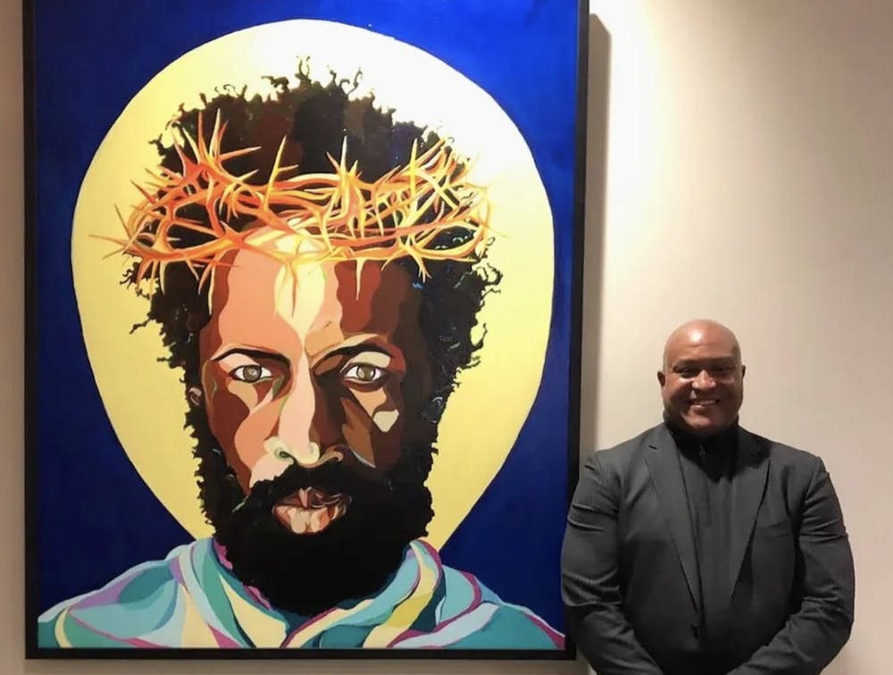 """Gerald Roulette, artist behind """"The Great I Am,"""" poses next to his work. Photo courtesy of Gerald Roulette.Photo courtesy of Gerald Roulette"""