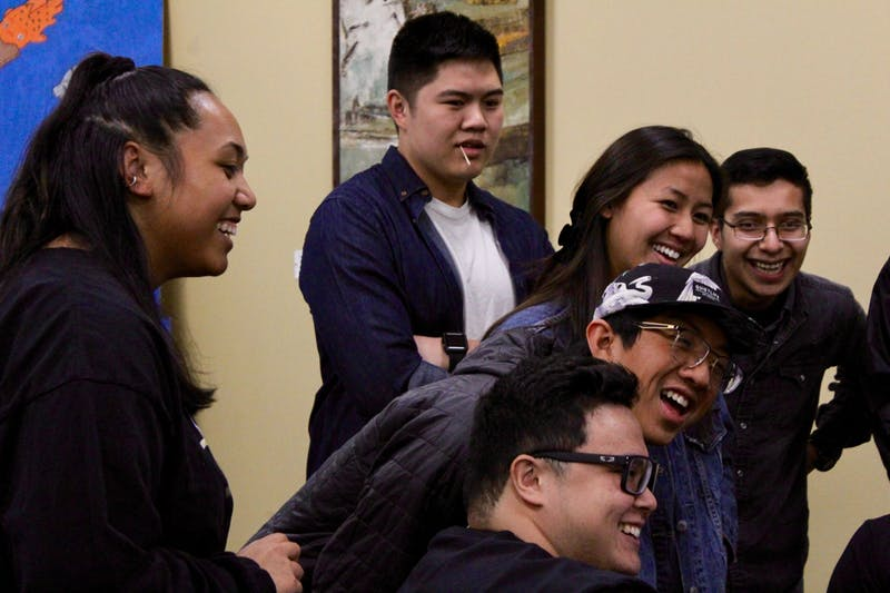 Members of the Hawai'i club and attendees of the Diversity Dialogue event enjoy a laugh together.