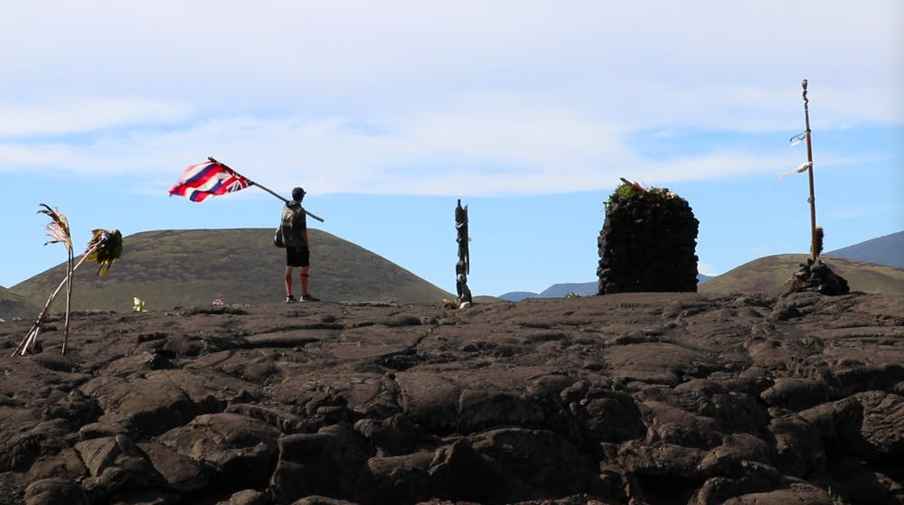 A protestor pays his respects at the place of worship on Mauna Kea.