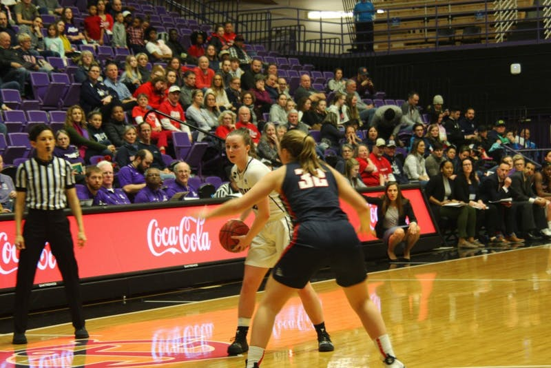 Sophomore Maddie Mulheim looks for an open pass.