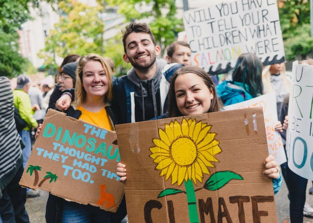 UP Students smile with their handmade signs at the Portland Climate Strike.