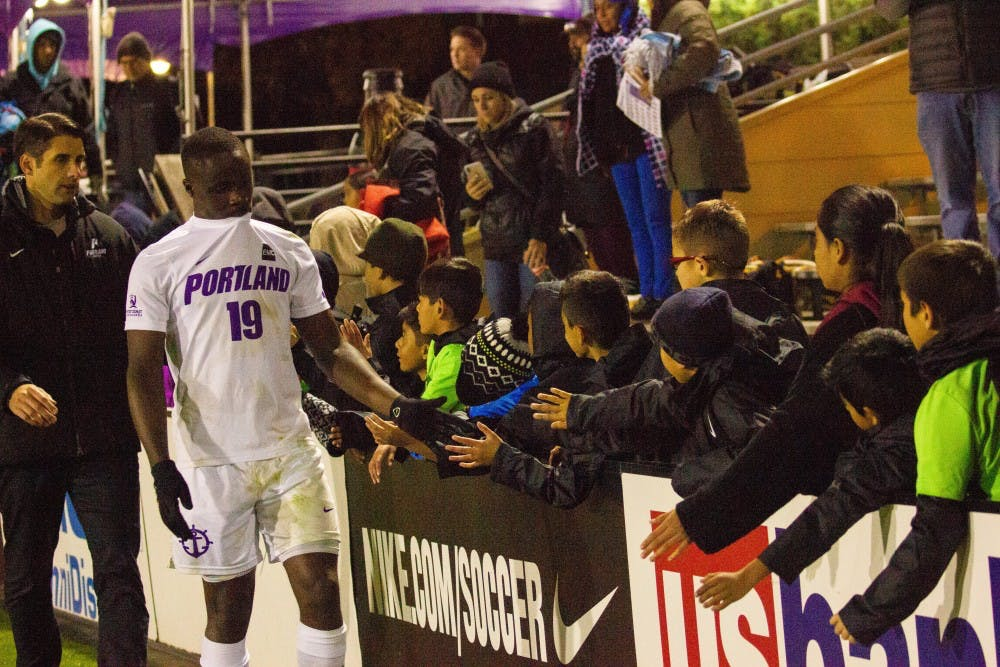 Junior striker Benji Michel greets fans after a tough loss.