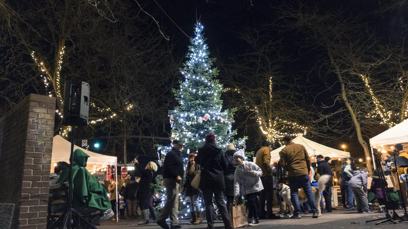 Locals gather around a Christmas tree in St. Johns.
