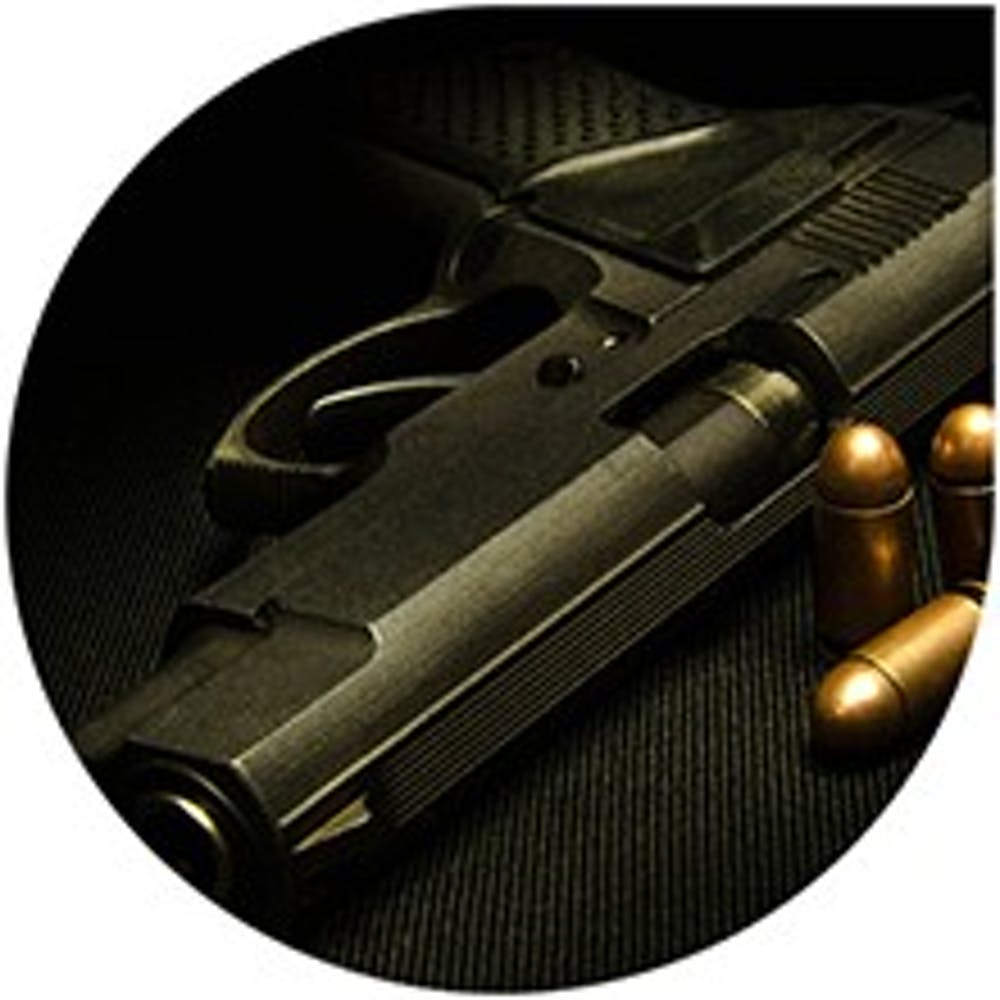 image_of_a_handgun_and_bullets