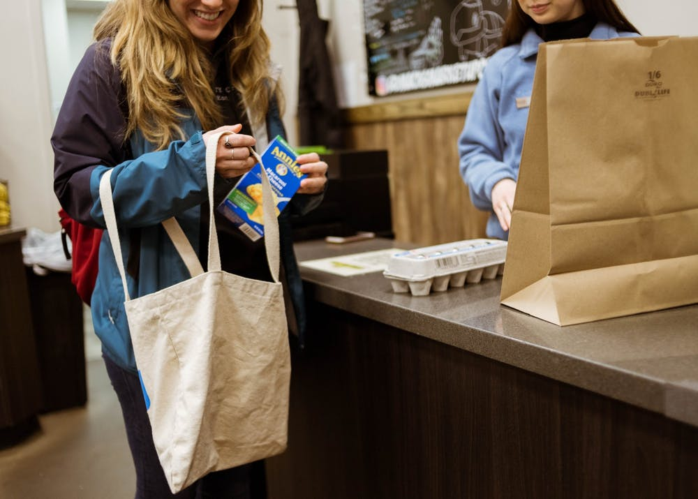 Mack's Market and the UP bookstore are  charging $0.05 for paper bags in accordance with an Oregon law that took effect Jan. 1, 2020. Photo illustration by Annika Gordon.