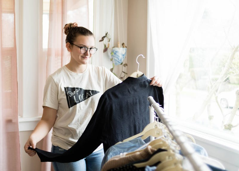 Senior Courtney Warta puts a spin on green fashion by selling second-hand clothing on Poshmark.