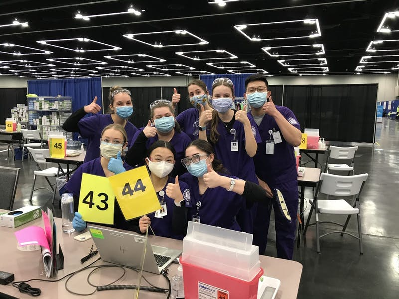 (Top left to bottom right)  University of Portland nursing students Sarah Rosander, Payton Bishoff, Natalie Parker, Bonnie Perkins, Lam Tran, Erin Collins, Madelyn Nguyen and Haley Santa Cruz pose for a photo. They administered vaccines at Oregon's Mass Vaccination site which is located in the Oregon Convention Center. Photo courtesy of the UP School of Nursing.