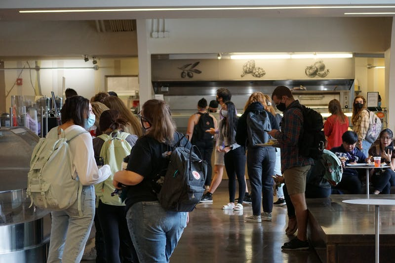 Students wait in line at The Commons.