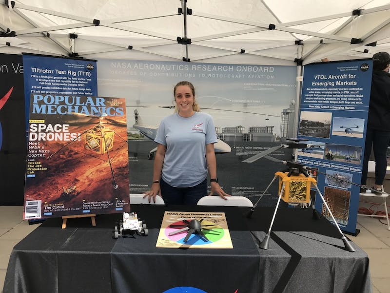 Lillia Smith works the NASA booth at a Tech Showcase in Mountain View. She was part of the outreach committee for the Aeromechanics branch. Photo courtesy of Lillia Smith.