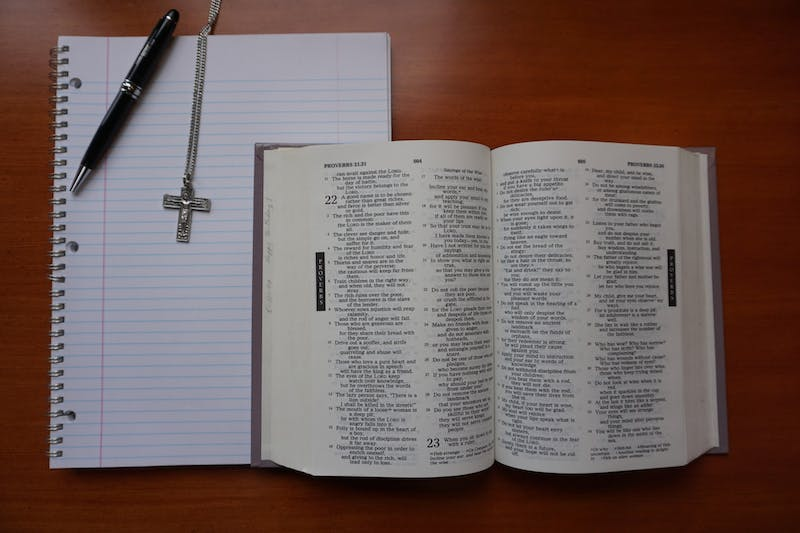 A Bible sits open ready to be read, analyzed and discussed. All UP students are invited to reflect, connect, and pray in small groups through the One Body Initiative. Photo Illustration by Marek Corsello.