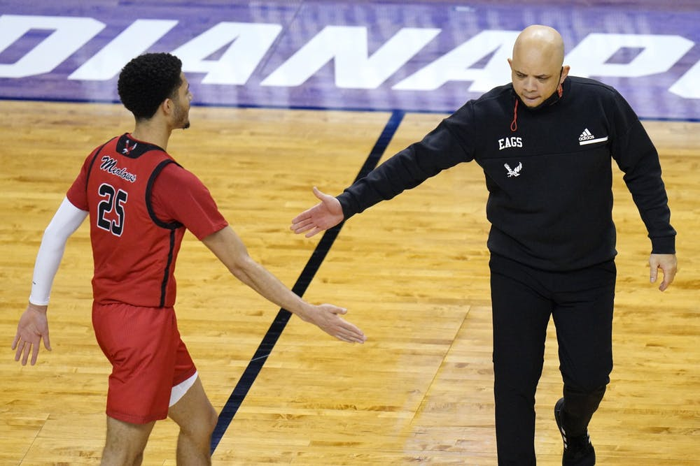 Eastern Washington head coach Shantay Legans welcomes Eastern Washington guard Michael Meadows (25) back to the bench during the second half of a first-round game against Kansas in the NCAA college basketball tournament at Farmers Coliseum in Indianapolis, Saturday, March 20, 2021. (AP Photo/AJ Mast)
