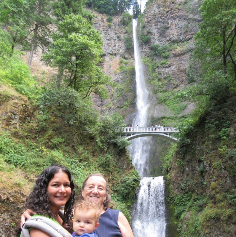 Psychology Professor Sarina Saturn (left) says that Multnomah Falls has always been one of her favorite places in the world. Here she is pictured with her then infant daughter, Sia, and a close friend. Photo courtesy of Sarina Saturn.
