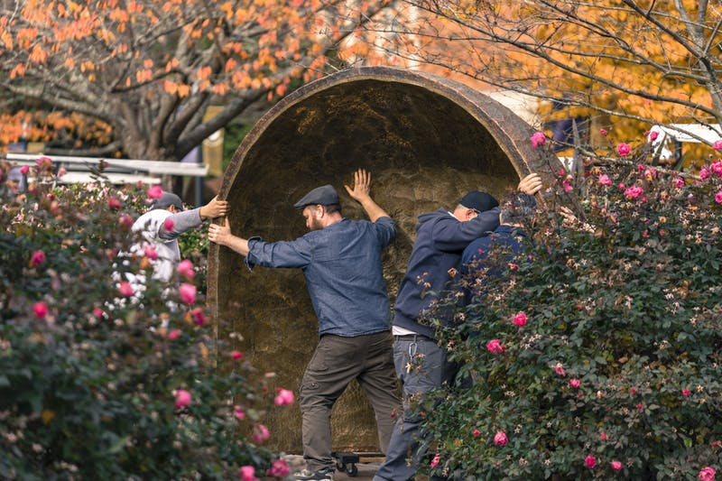 Physical Plant workers install the Grotto in the Marian Garden by the Bell Tower.