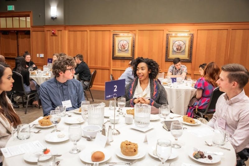 A photo of last year's Ethics Week event, where students and speakers gathered for more personal conversation. Photo courtesy of the University of Portland webpage