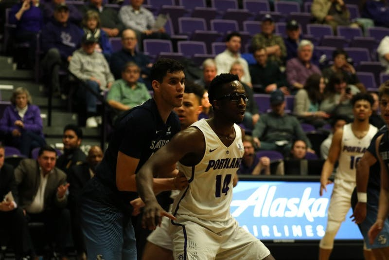 Sophomore power forward Tahirou Diabate is marked by another player.