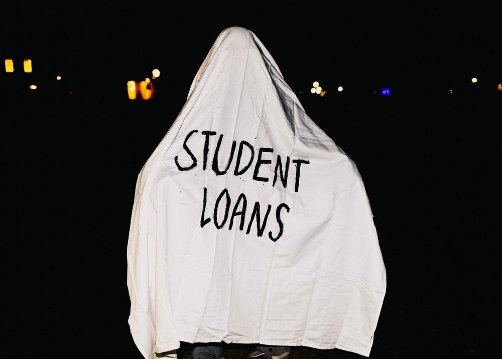 The most haunting costume of them all: Student Loans. Photo illustration by Molly Lowney.