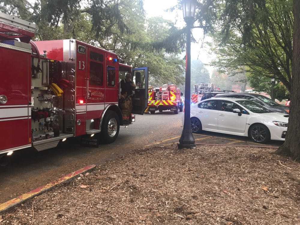 Firefighters arrive at Kenna Hall to put out a brush fire below campus. Adrienne Clark was charged with four counts of reckless burning in connection to the fires.