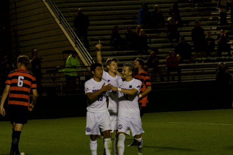 Rey Ortiz celebrates with his teammates after scoring a penalty kick.
