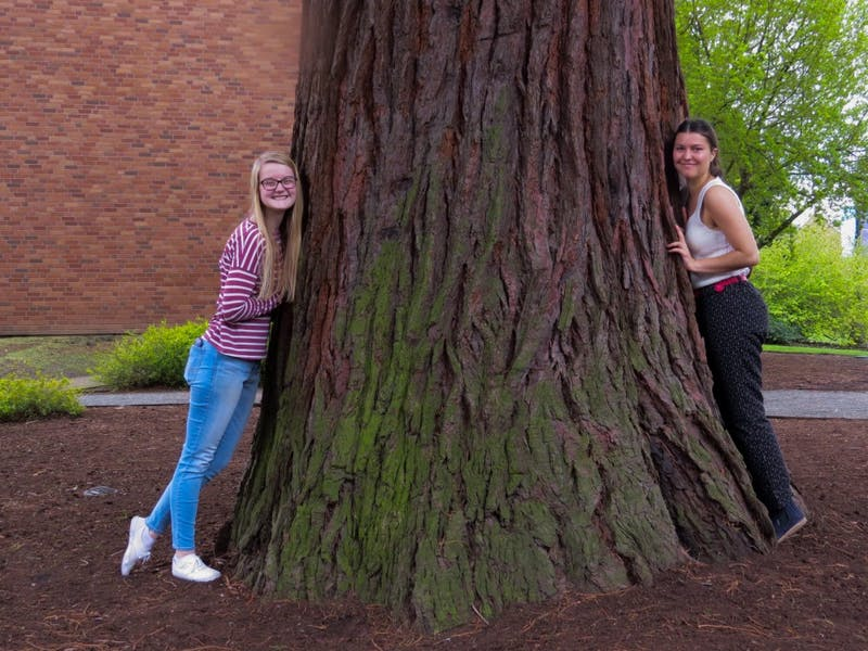 Community Engagement Editor Natalie Nygren poses with College Ecology Club President Ruby Beauchamp.