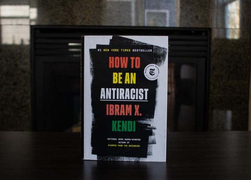 """Ibram X. Kendi's """"How To Be An Antiracist"""" was published in August 2019. Here, Kendi discusses his experience with racism and  shows readers that it is not enough to be 'not racist', but they must strive to be actively antiracist.Photo Illustration by Emma Sells"""