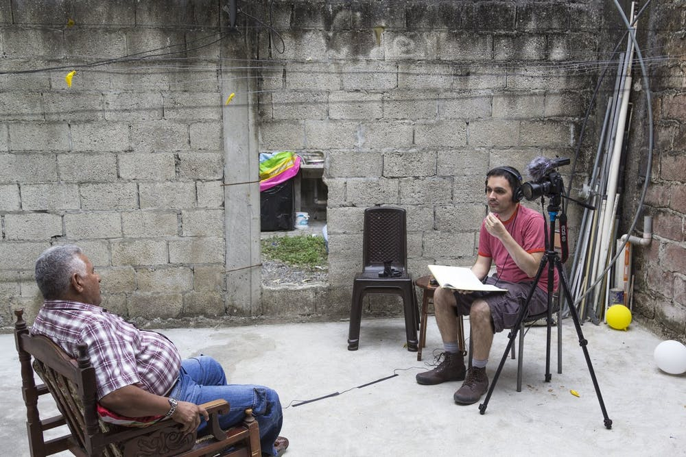 "José Velazco conducts an interview for his documentary, ""En Vida,"" in 2016. Image courtesy of José Velazco."