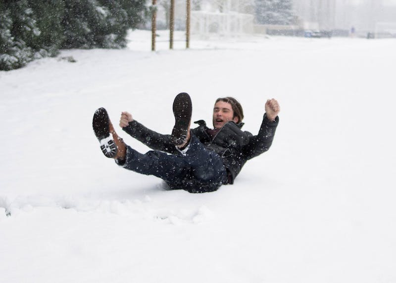 With classes canceled Tuesday afternoon for a snow day, students were found laughing, skipping, dancing, catching snowflakes with tongues out, and overall using snow walks and time with friends to procrastinate homework and studying just a little longer.