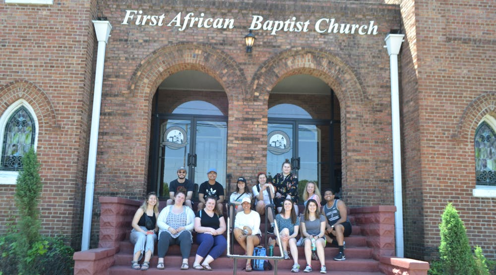 The Civil Rights Immersion group sit outside the First African Baptist Church in Savannah, GA. Photo Submission by Lauren Urbina