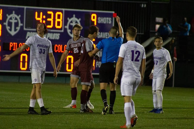 Portland takes a one man advantage after Colgate senior defenseman Christian Clarke receives a red card in the 95th minute.