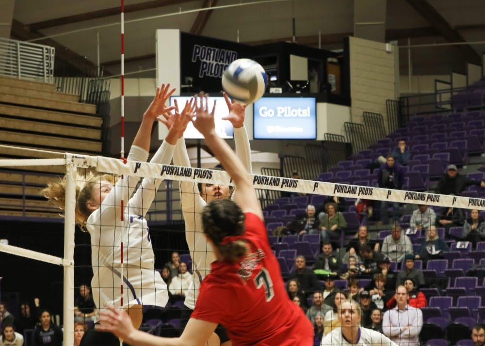 Liz Reich and Katie Barker go for the block.