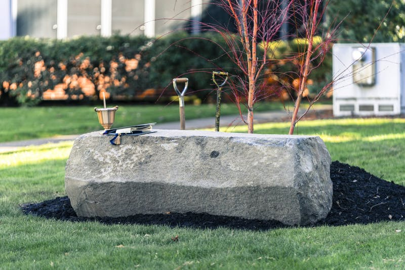 A stone bench and a Japanese Maple tree outside Christie Hall commemorate the life of Owen Klinger.
