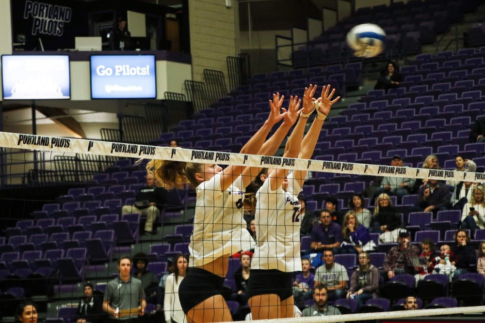 Liz Reich and Katie Barker go for the block in a game against St. Mary's.