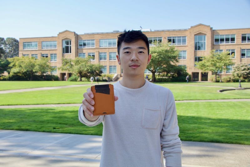 Senior Devin Ajimine and founder of the Paramine Wallet shows off his product.