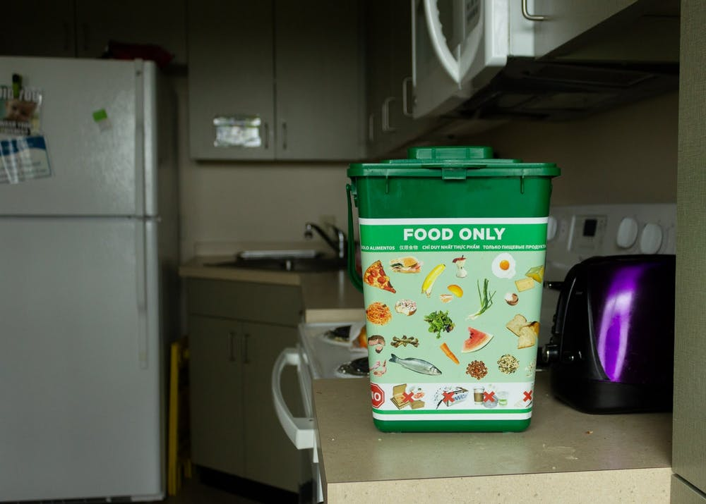 These compost bins are available in all student dorms for residents to dispose of food waste.