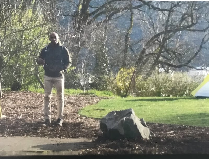 Robert Johnson Patterson, 39, stands by a tent he pitched near the SLUG garden. This photo was attached in a campus-wide email sent out Tuesday by Public Safety Director Gerald Gregg. It is unclear how and when the photo was taken.