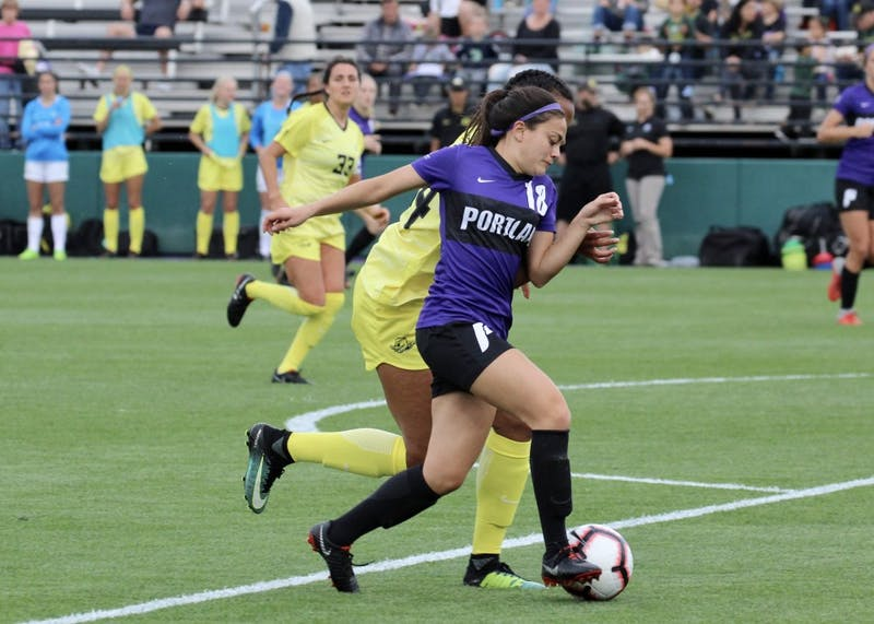 Junior Rachel Khaw tries to beat an Oregon player to the ball.