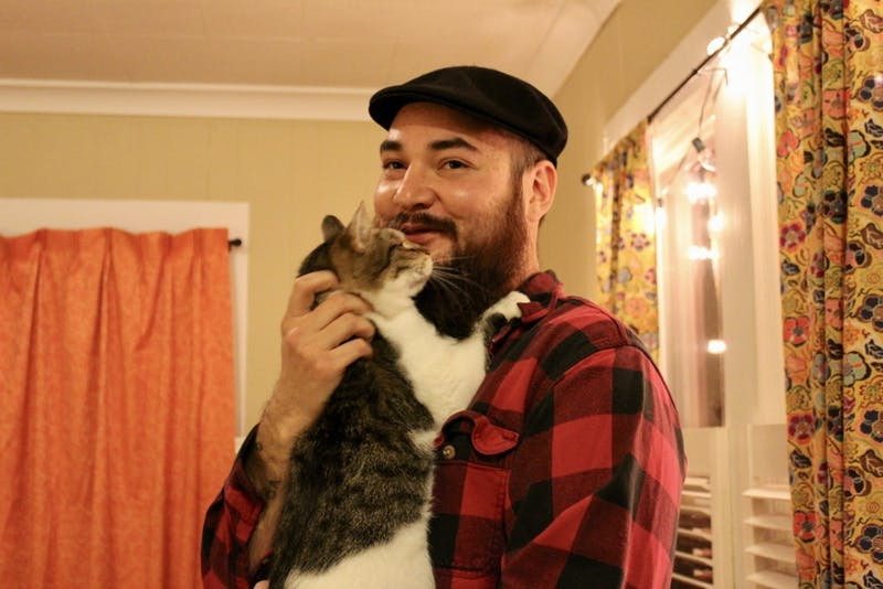Joseph Mah says that his wife, Mallory Kanaeholo, has worked as a Veterinary Technician for years and had adopted three cats before he met her. Mah has a particularly close bond with Kwitten, pictured here, who likes to rub his face on Mah's beard.