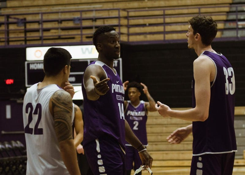 Tahirou Diabate and Jacob Tryon talk during practice. Both big men will play a pivotal role for the Pilots this season.