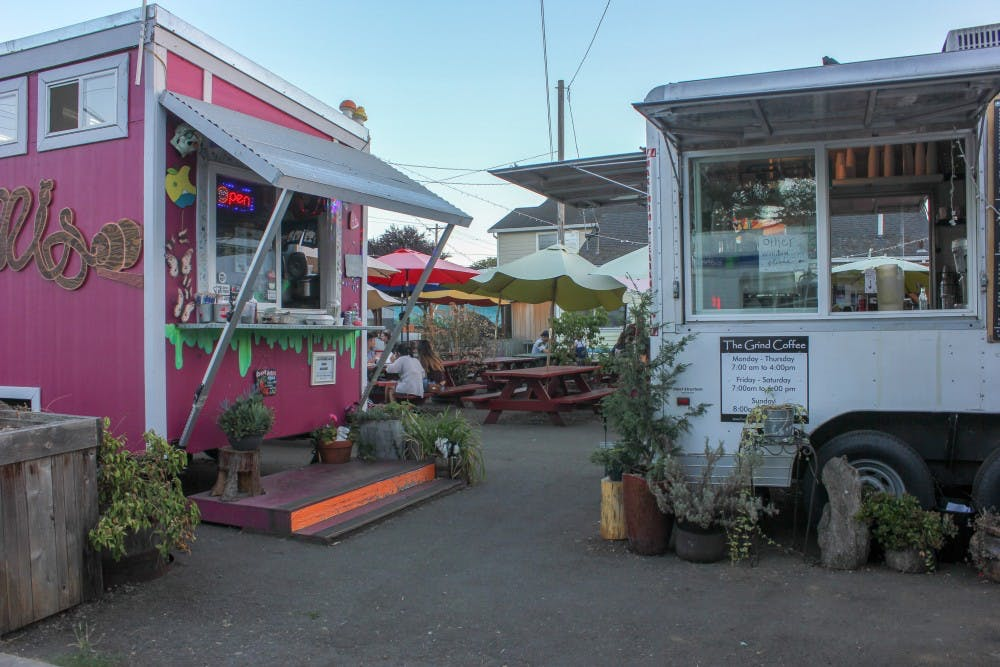 The St. Johns food carts on Lombard include places like The Grind Coffee and Falafel House.