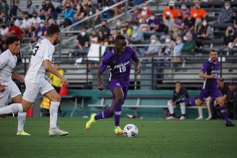 Buba Fofanah advancing the ball.