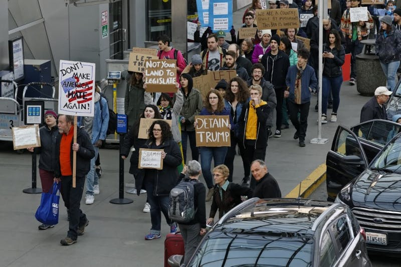 Dozens of demonstrators marched in and around the main terminal at Portland International Airport, to protest President Donald Trump's order restricting immigration into the U.S. Saturday. The protests continue. (Mike Zacchino/The Oregonian via AP)