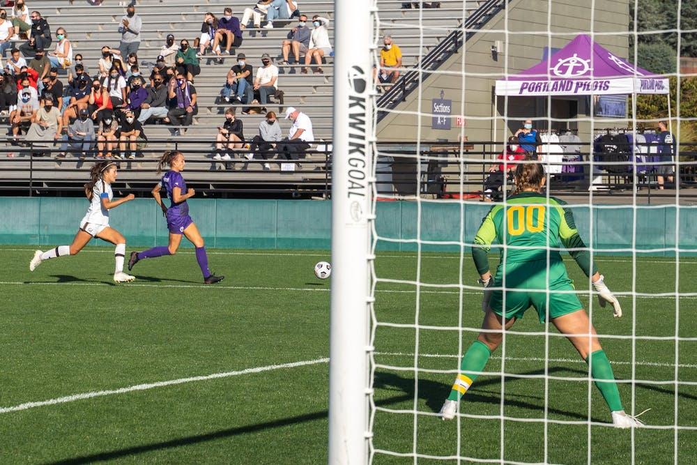 Forward Taryn Ries dribbles towards the California goal.