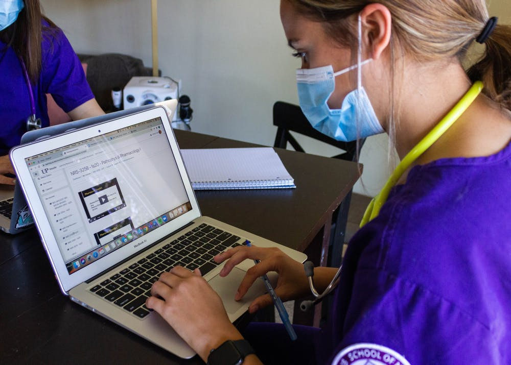 Junior nursing major Ashley Cole scrolls through her online nursing courses. Due to the COVID-19 pandemic, upper-division nursing clinicals, typically held in person, were moved largely online.
