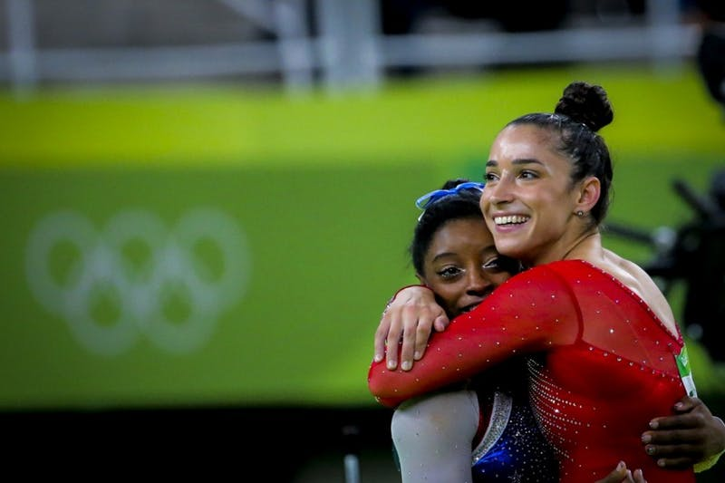 Simone Biles (left, gold) and Alexandra Raisman (silver), both from the USA, at the Olympic Games in Rio after competitions in all-round. Biles and Raisman are two out of numerous athletes who have been sexually assaulted by former USA Gymnastics doctor Larry Nassar. Photo by Danilo Borges/brasil2016.gov