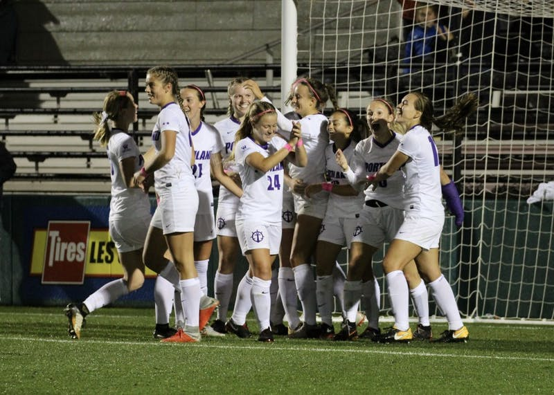 The women's soccer team celebrates the first goal of the game, ten seconds before the first half ends.