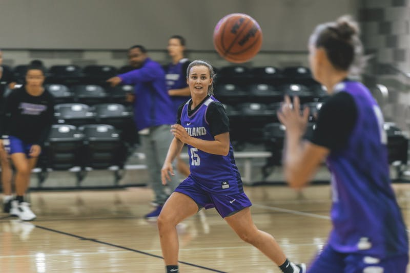 Junior Maddie Muhlheim passes the ball to a teammate on the fly during practice.