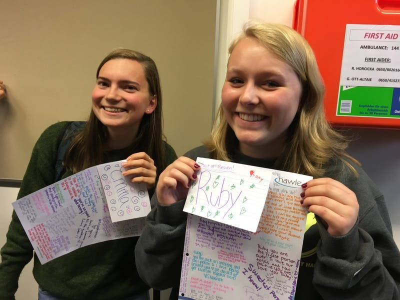 Emma Wells and Ruby Lindgren hold up compliment cards they received from other members of Active Minds in Salzburg. Photo courtesy of Kylie Koney.